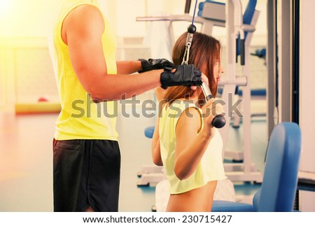 Young girl and trainer in gym
