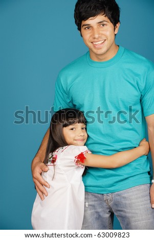 Young girl and young man smiling at camera