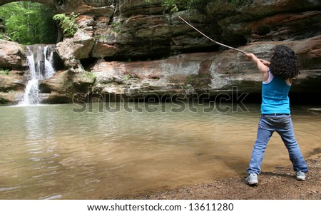 Young girl at a waterfall in Hocking Hills State Park, Ohio