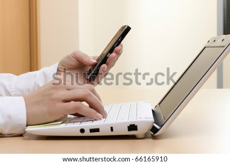 Young girl at office on the workplace makes call. - stock photo