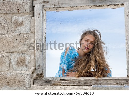 Young girl at old brick framework
