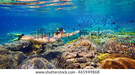 Young girl at snorkeling in the tropical water. Traveling, active lifestyle concept.