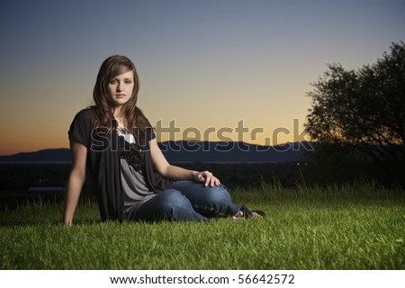 Young girl at sunset looking very natural - stock photo