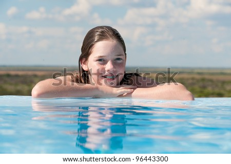 young girl at the edge of a pool