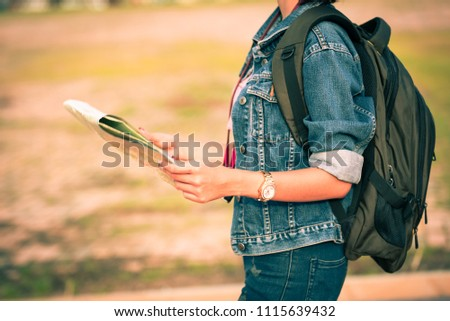 Young girl backpack tourist hand holding a map for search and plan her tour.Woman traveler touring in the summer. #1115639432