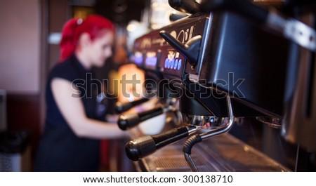 young girl Barista prepares coffee in pub, bar, restaurant