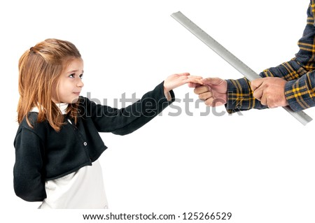 Young girl being physically punished by teacher with a ruler - stock photo