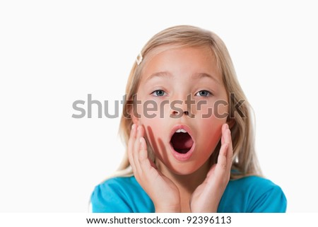 Young girl being scared against a white background