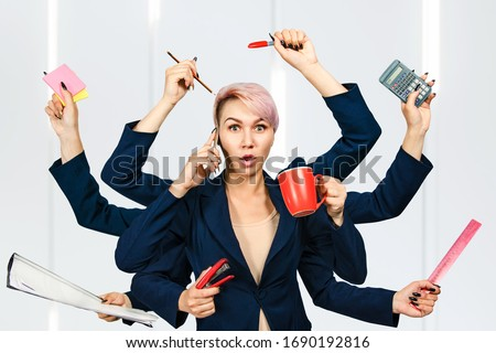 Young girl busy shiva office manager with many hands keeps supplies. Foto stock ©