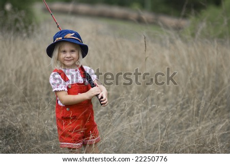 Young girl carrying a fishing pole and tackle box stock for Little girl fishing pole
