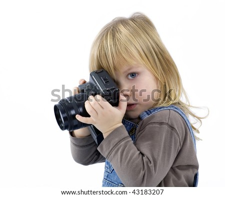 Young girl, child, trying to shoots photos on white background
