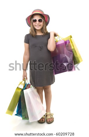 young girl child with shopping bags isolated on white
