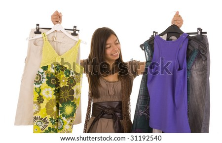 Young girl choosing new clothes isolated on white