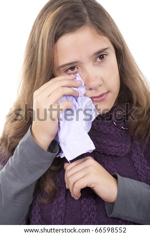 young girl cleaning her tears