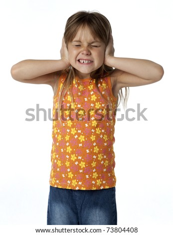 Young girl covering her ears with her hands, eyes closed, white background.