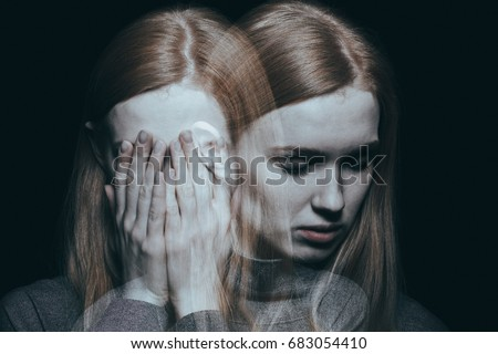 Young girl covering her face with her hands after reaching a peak of her depression