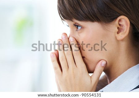 young girl crying closed  face in his hands