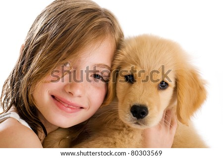Young Girl cuddling with a cute Golden Retriever Puppy - stock photo