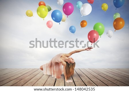 Young girl dance with colorful balloons