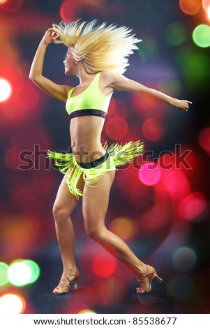 Young girl dancing Latin dance