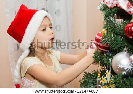 Young Girl Decorating Christmas Tree