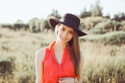 Young girl doing emotion.Dressed in a black shirt, black sweater,black hat,glasses and bright lips,trendy clothes red jaket,outfit and hat,vacation style,bright colors.Sensual woman