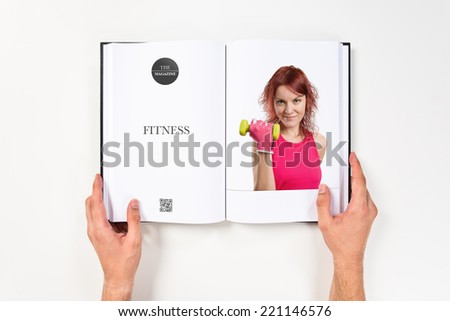 Young girl doing weightlifting printed on book #221146576