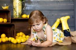 Young girl eating a sour lemon slice.