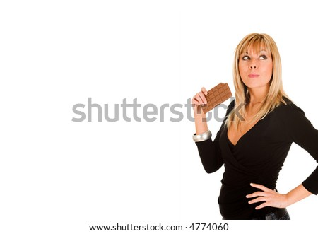 young girl eating chocolate on white background