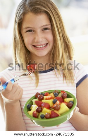 Young girl with gift stock photo Closeup of a laughing young girl with ...