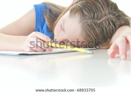 Young girl falling asleep during school work