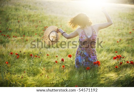 Young girl feeling freedom in green field.