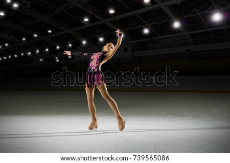 Young girl figure skater in sports hall #739565086