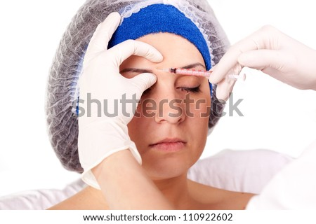 young girl getting Botox injection procedure - stock photo