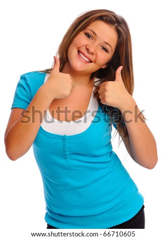 Young girl gives a thumbs up as a sign of approval