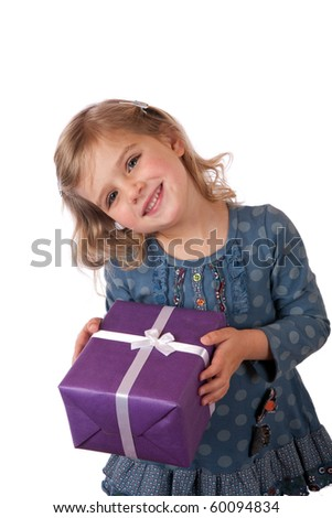 Young girl giving a present