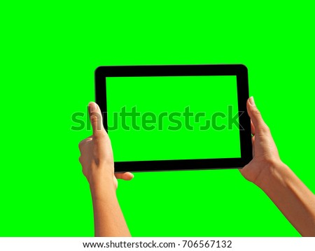 Young girl hand holding a tablet on green screen #706567132