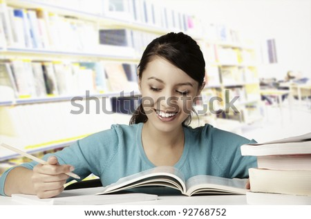 young girl happily doing her work