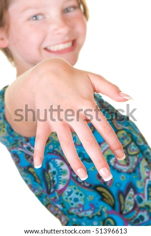 young girl happy to show off press-on nails - stock photo
