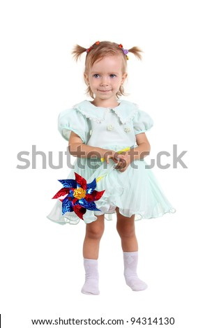 Young girl happy with wind toy on the white background