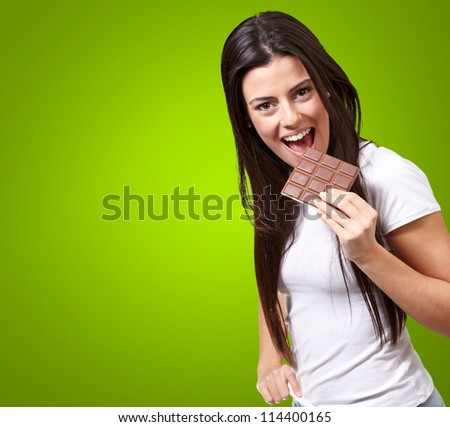 Young Girl Having Chocolate Isolated On Green Background