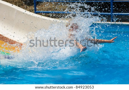 young girl having fun in aqua park