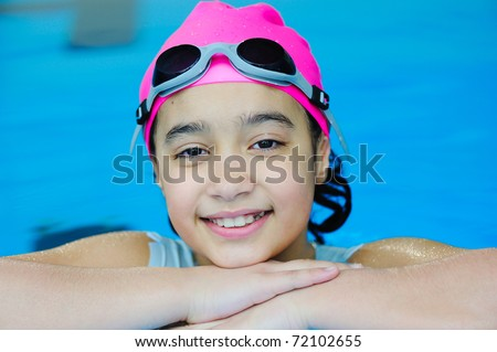 Young girl having good time in the pool