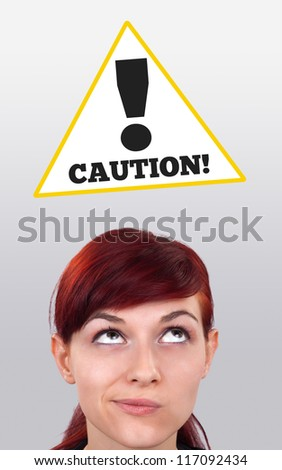 Young girl head looking at construction signs - stock photo