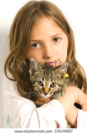 Young girl holding a cute kitten