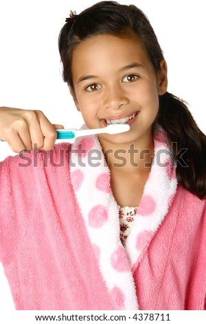Young girl holding a toothbrush against her teeth, as a healthy everyday morning and night routine for dental hygiene.