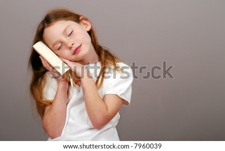 young girl holding Bible in thoughtful pose