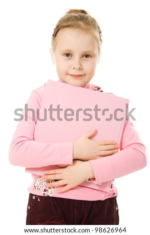 Young girl holding books on a white background.