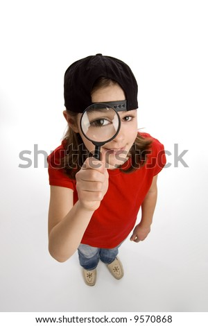 Young girl holding magnifying glass
