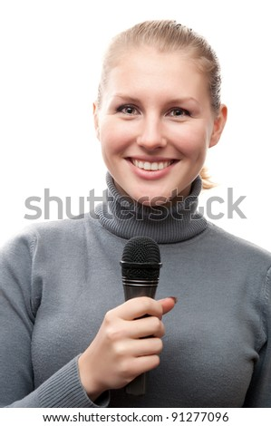 young girl holding microphone and smiling isolated on a white background